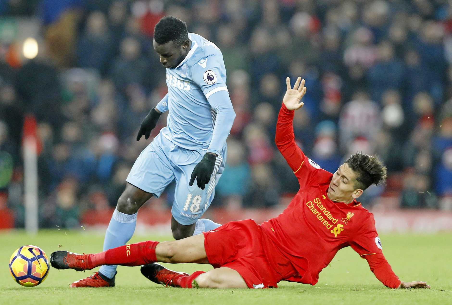 Stoke City's Mame Biram Diouf (left) and Liverpool's Roberto Firmino battle for the ball.