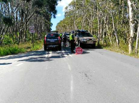 CHECKPOINT: Police conduct RBT testing on drivers entering and leaving the Third Cutting on Noosa's North Shore. Photo: Lindsay Dines