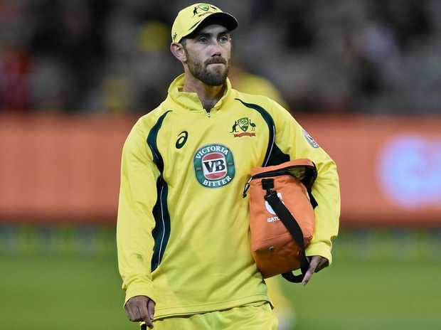 Glenn Maxwell of Australia carries the drinks during the third ODI against New Zealand.