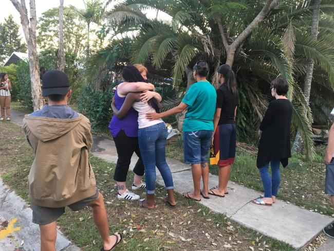 Friends of the accused driver console mourners for Josiah Sisson, 9, in Springwood this evening. Pic: Madura McCormack