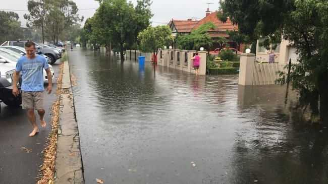 A flooded street off New St, Brighton. Picture: Mathew Langdon