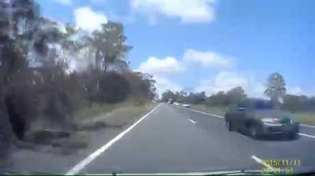 A motorist attempts a dangerous manoeuvre on the Cunninghams Gap, near Aratula.