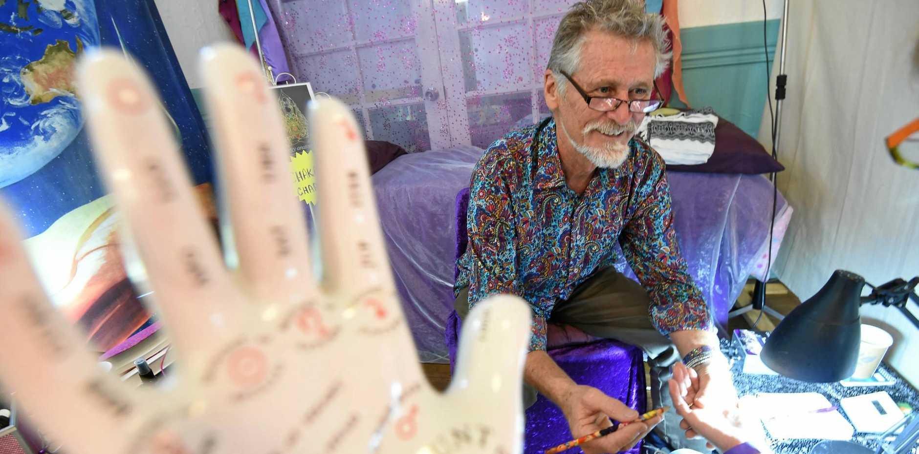 MASTER PALMIST: Ian Cameron gives a reading at the Moonlight Mystic Fair in Bangalow.