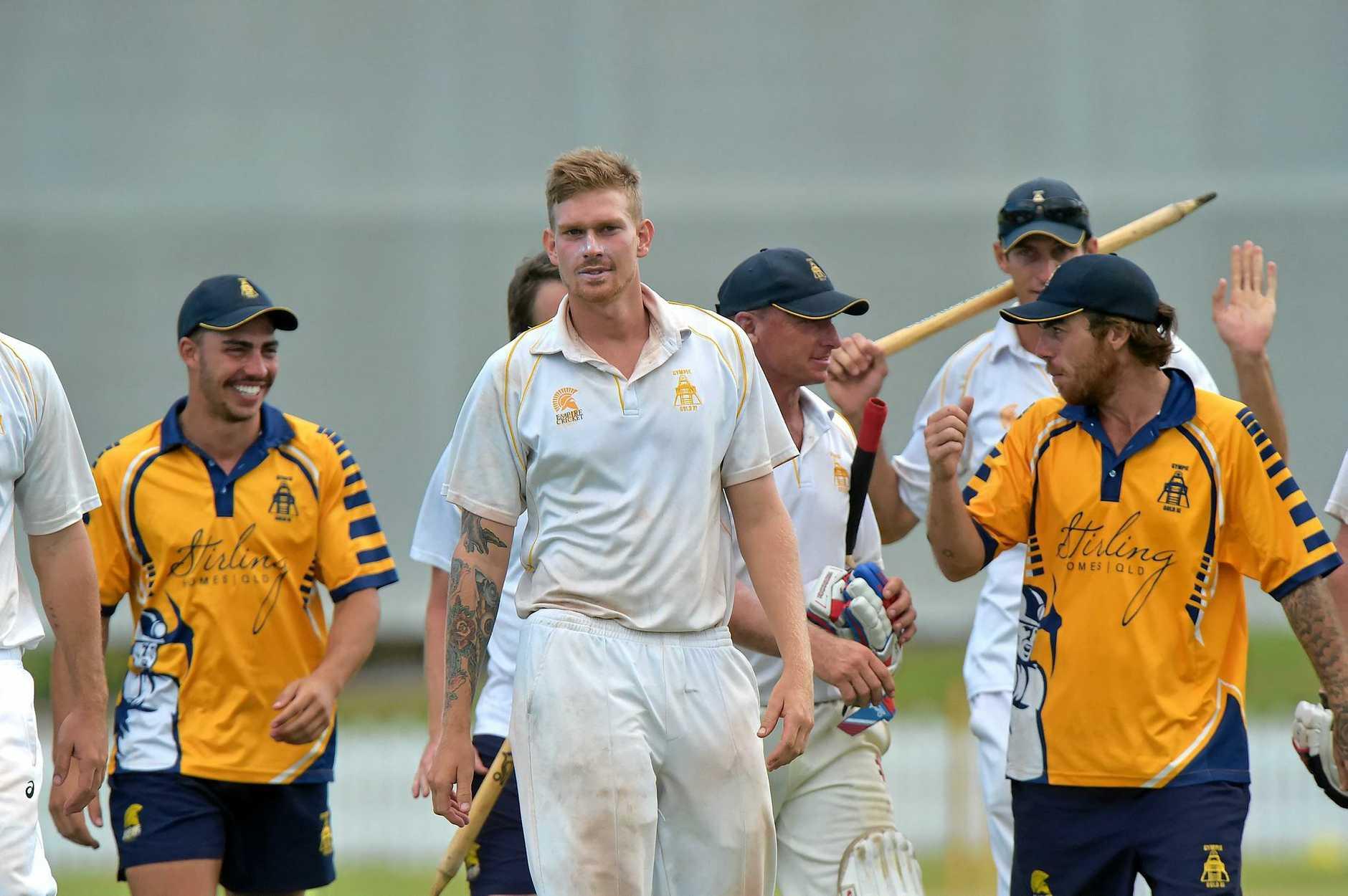 Maroochydore Blue against Gympie cricket grand final. Gympie celebrate the win Josh Brady (centre) walks off with his team. Photo: Warren Lynam / Sunshine Coast Daily