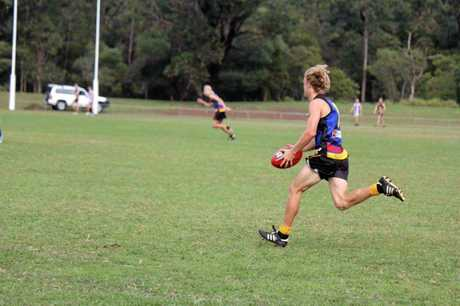 FROM LEFT TO RIGHT: Bradley Kimberley in action for Caloundra. Timothy hunts a loose ball.