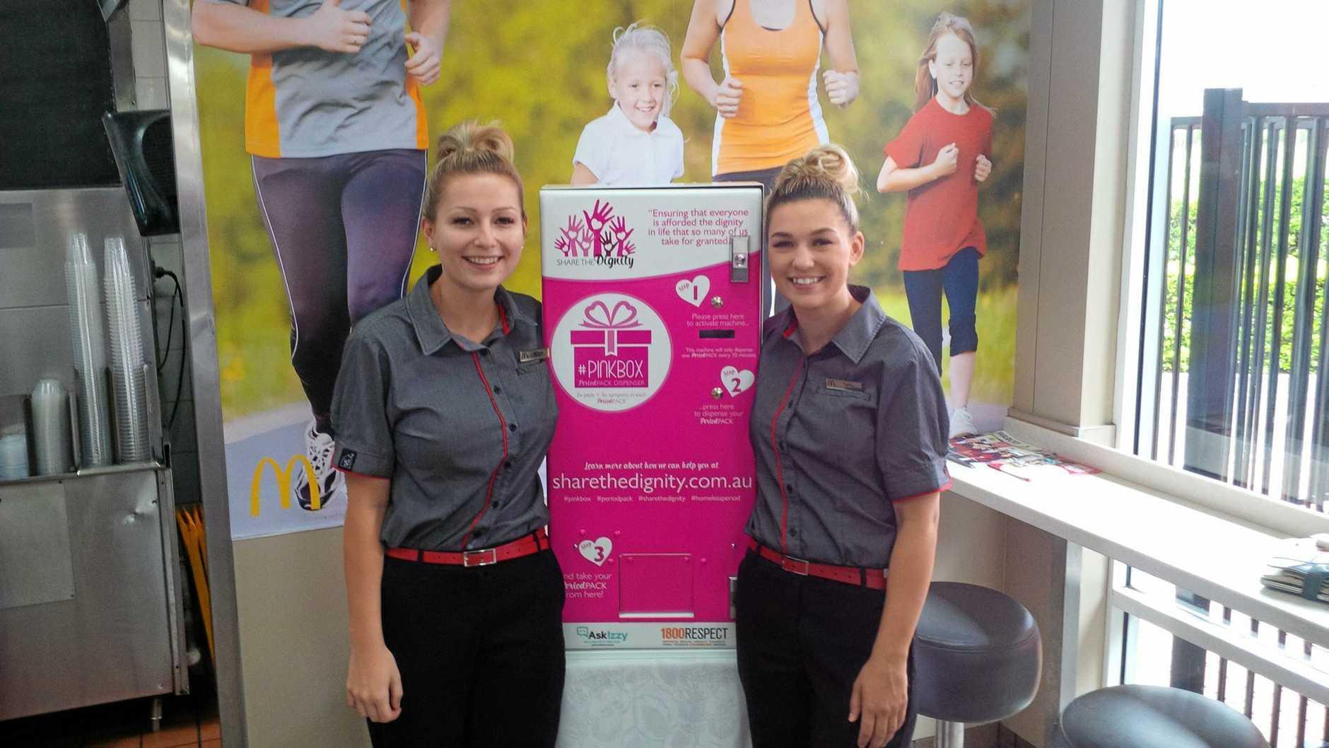 Bracken Ridge McDonald's managers Brittney Dalton and Talitha Dalton with a Pink Box vending machine.