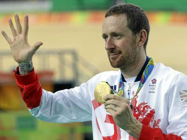Sir Bradley Wiggins of Britain on the podium with his gold medal after the men's team pursuit final at the Rio Olympics.