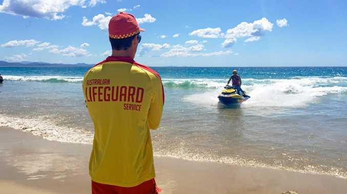 PATROL: Byron based lifesaver Lorne Greenlaw returns from patrolling off Main Beach Byron Bay watched by Jai Sheridan Photo Christian Morrow / Byron Shire News
