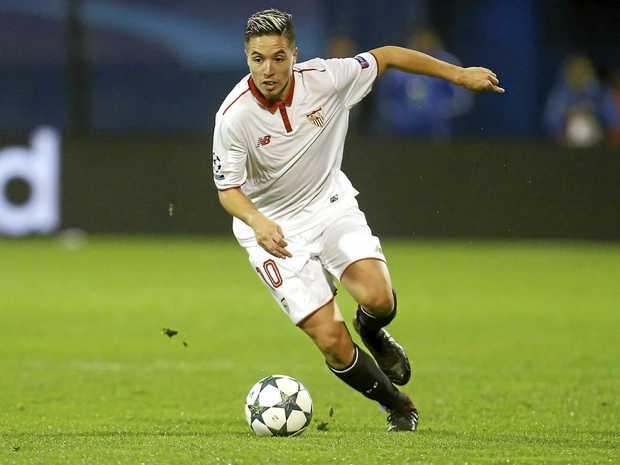 Sevilla's Samir Nasri controls the ball during a Champions League match.