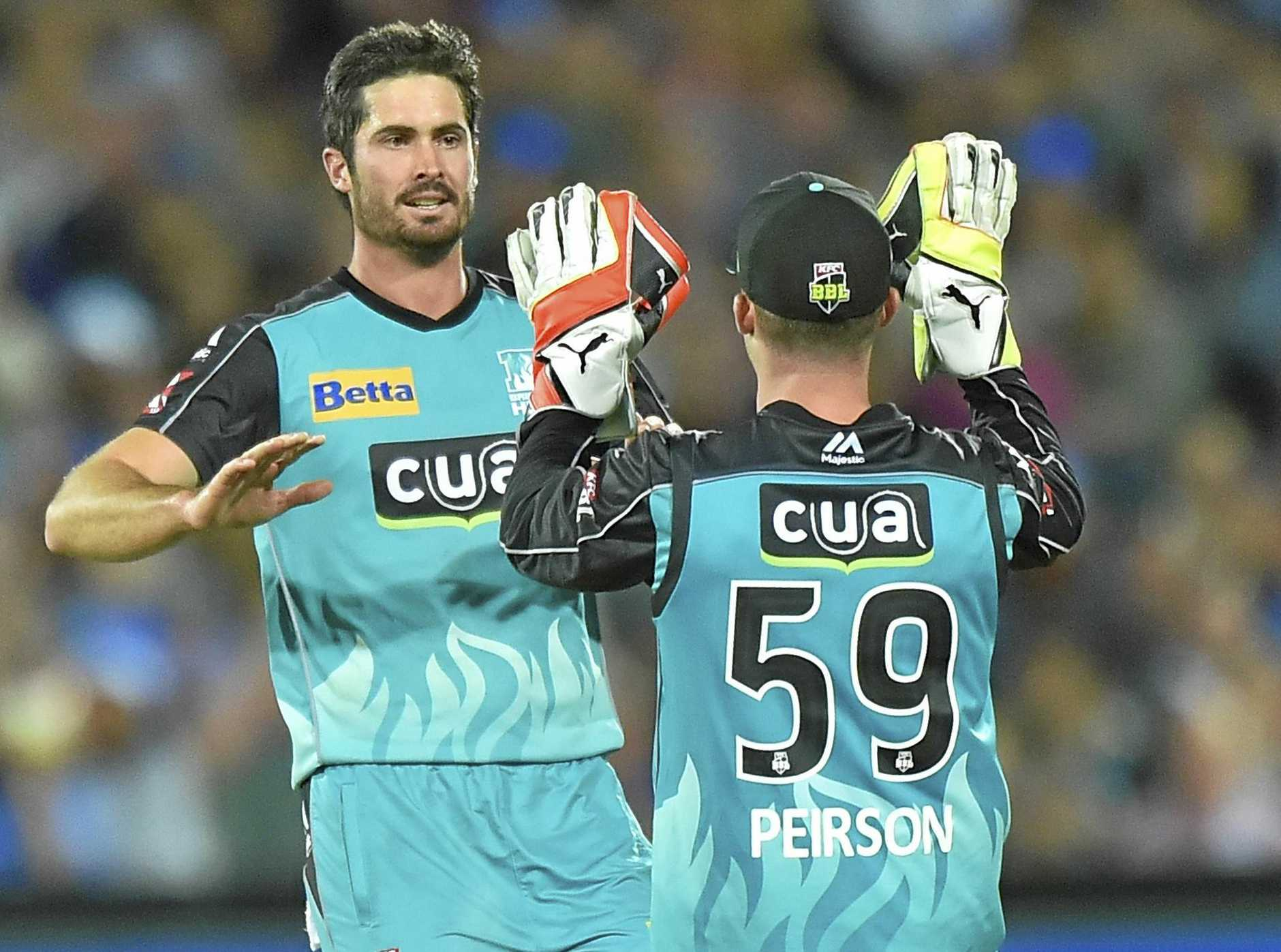 Ben Cutting (left) and Jimmy Peirson of the Heat celebrate a dismissal.