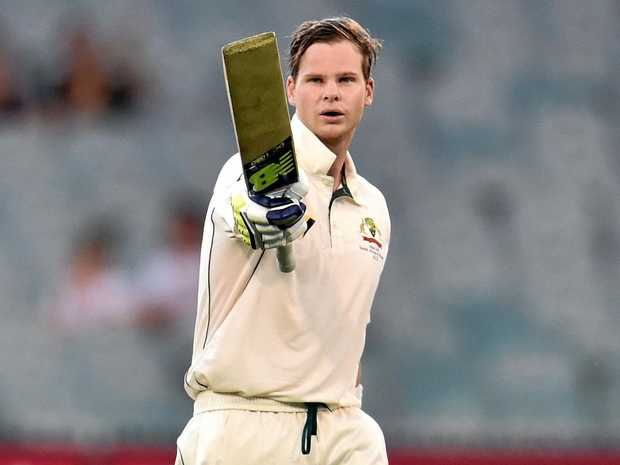 Australian skipper Steve Smith celebrates his century against Pakistan at the MCG yesterday.