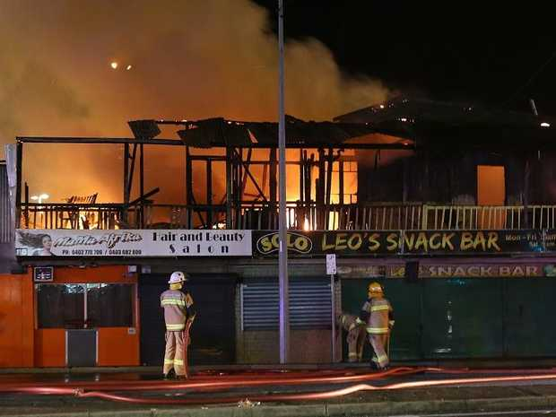 Firefighters at the scene of a huge blaze at a business on the Magic Mile at Moorooka. PIC: Marc Robertson.
