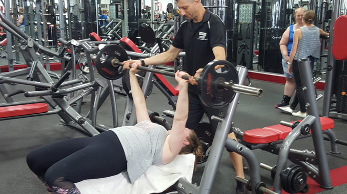 Personal trainer Lawrence Lubke, pictured training a client at Snap Fitness Yamanto, offers his advice on how to stick to New Year's resolutions.