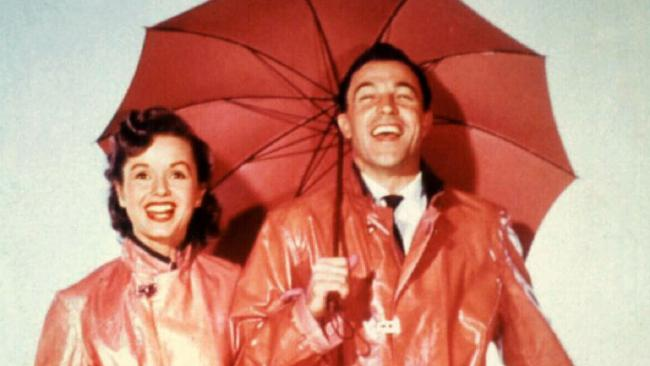 Debbie Reynolds with Gene Kelly in Singing in the Rain.Source:News Limited