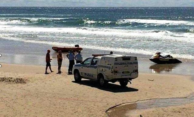 Police make an arrest on Airforce Beach, Evans Head.
