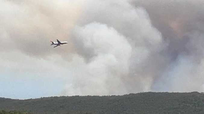 The DC-10 VLAT water bombing the fire at South Evans Head bombing range.