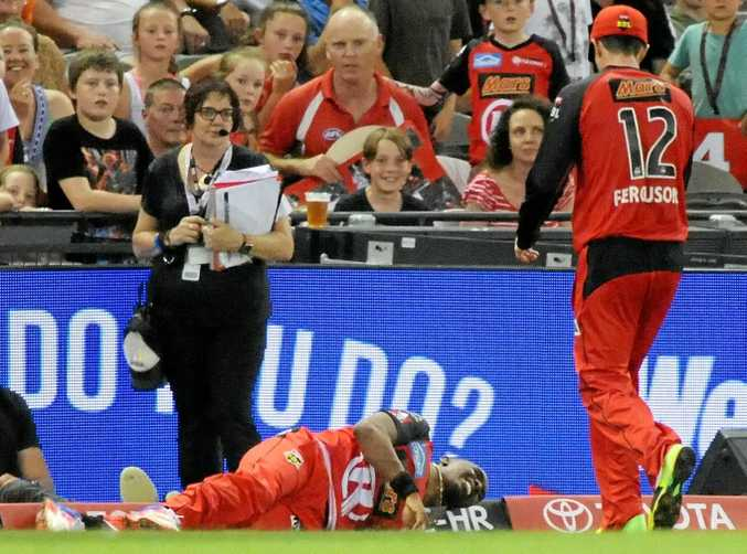 DOWN AND OUT: Dwayne Bravo of the Renegades in agony after injuring his leg.