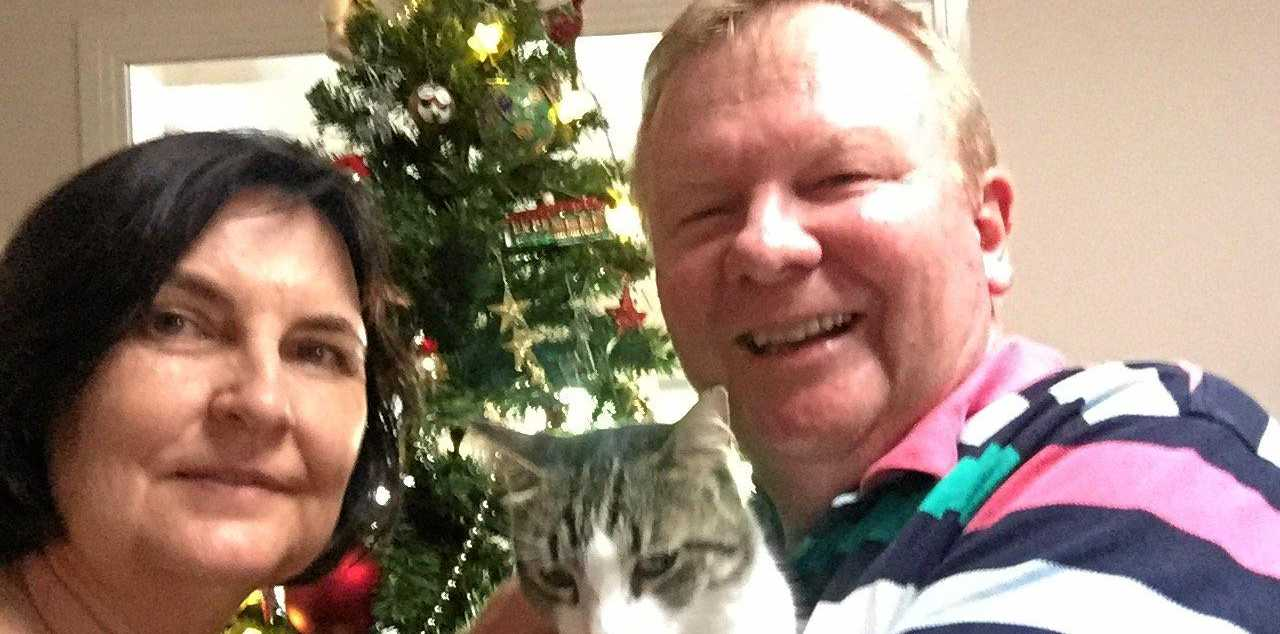 CHRISTMAS SELFIE: Julieanne Gilbert with her husband Frank know their cat Puss really runs the household.
