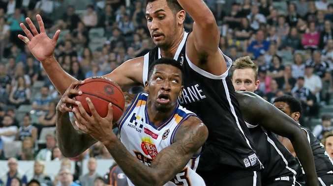 Torrey Craig of the Brisbane Bullets drives to the basket against Melbourne United.