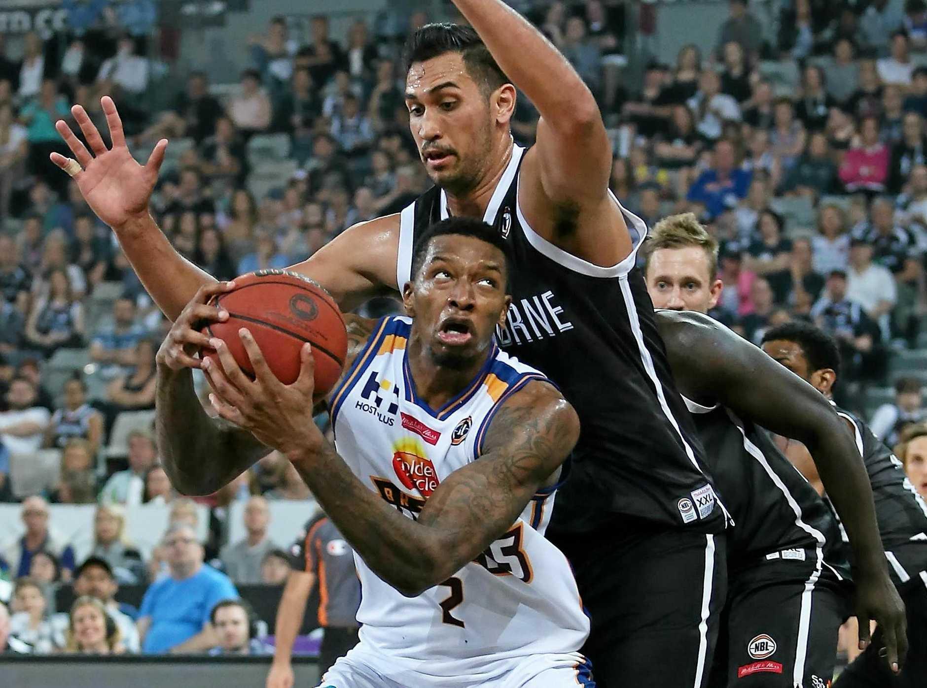 Torrey Craig of the Brisbane Bullets drives to the basket against Melbourne United.
