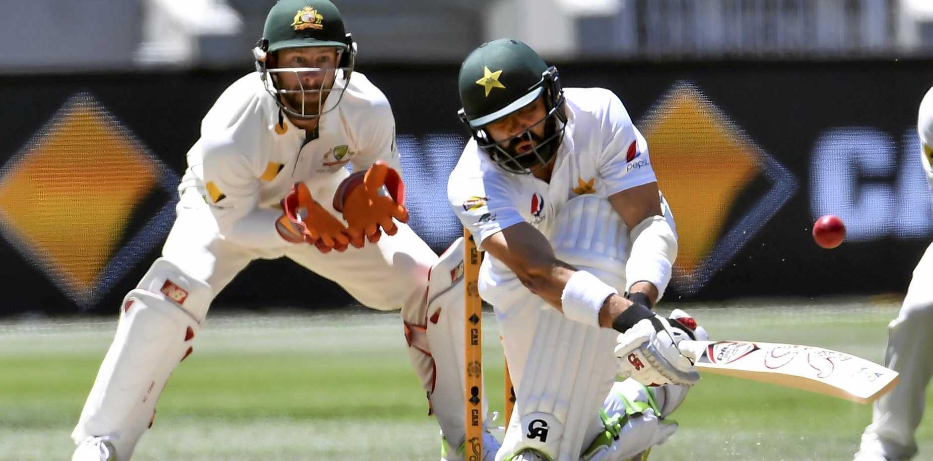 Australia's Matthew Wade (left) watches Pakistan's Misbah-ul-Haq play a sweep shot at the MCG.