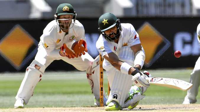 Australia's Matthew Wade (left) watches Pakistan's Misbah-ul-Haq play a sweep shot at the MCG.