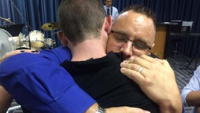 Karl Sisson embraces Adrian Murray this week.