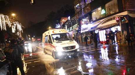An ambulance rushes from the scene of an attack in Istanbul.