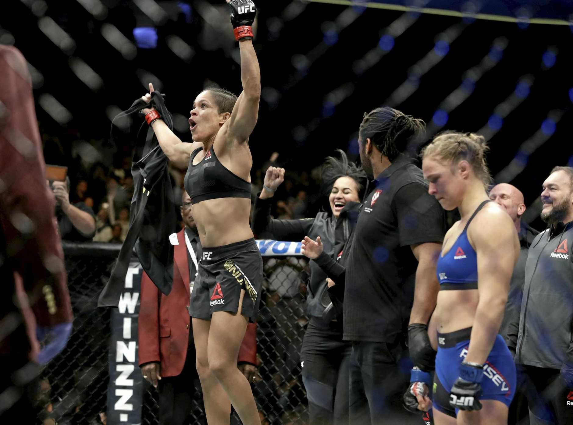 Amanda Nunes celebrates after defeating Ronda Rousey.