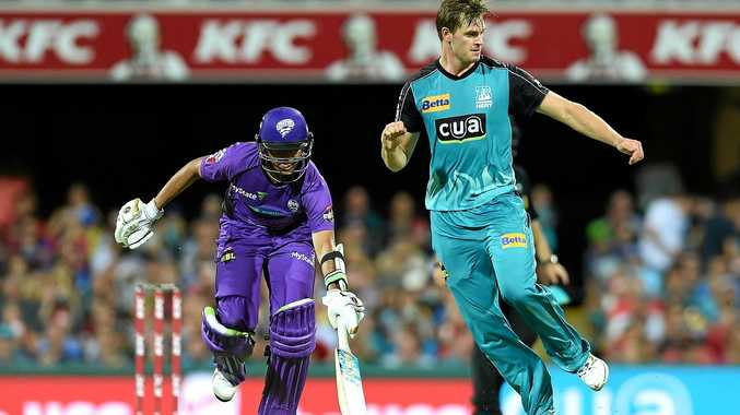 Clive Rose of the Hurricanes (left) makes it home ahead of Brisbane Heat bowler Mark Steketee during the Big Bash League match between the Brisbane Heat and the Hobart Hurricanes at the Gabba on Friday.