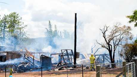Fire crews work desperately to contain the house fire at Lagoon Pocket