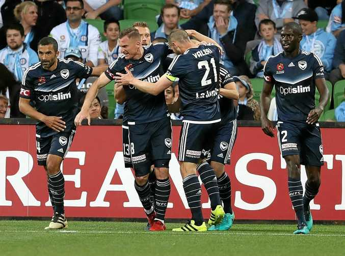Marco Rojas of the Victory celebrates after scoring a goal in the Melbourne derby.