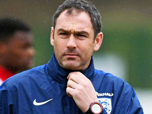 Coach Paul Clement looks on during an England under-21 training session.