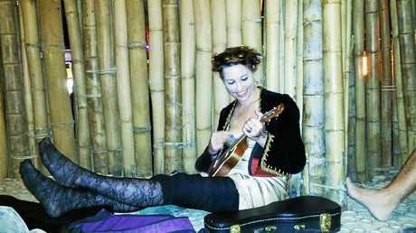 US artist Amanda Palmer kicks back with her ukulele at Woodfordia on New Years Eve.