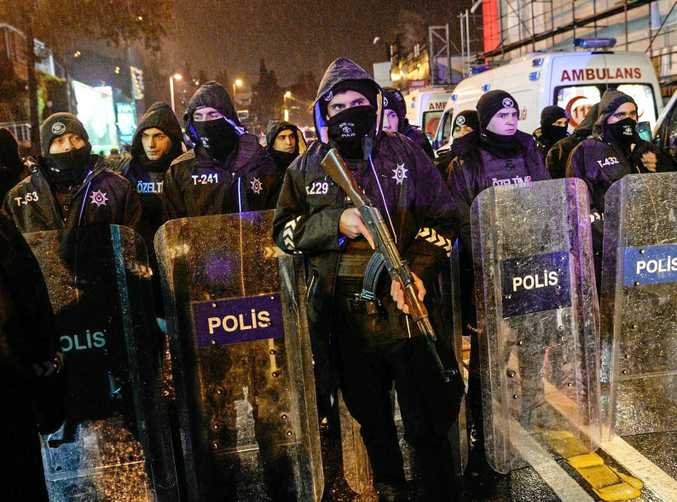 NIGHTCLUB TRAGEDY: Turkish riot police officers secure the area after a gun attack on a popular nightclub in Istanbul killed at least 35 New Year's Eve revellers.
