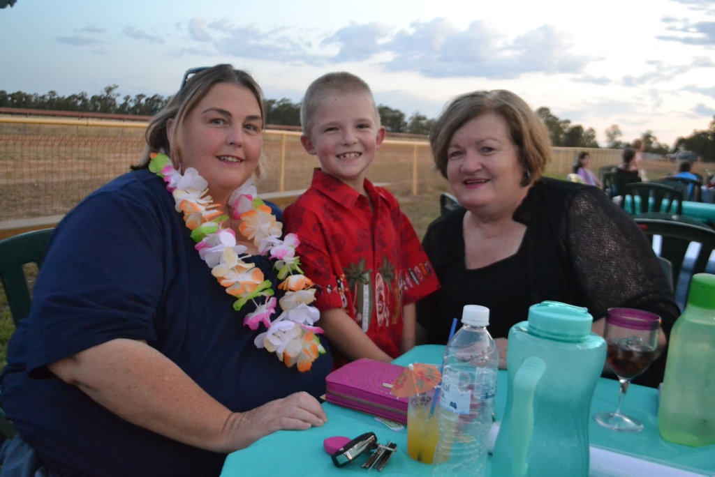 Image for sale: Kaye and Tom Coleman with Wendy Carroll at the Miles New Years Eve beach party celebrations. 31/12/16.