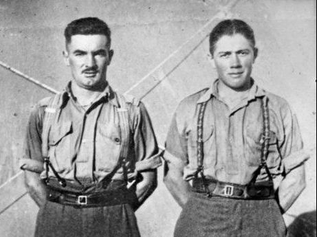 MATES IN ARMS: Private Joseph John Egan, of Allansford, Vic, (left) and VX42936 Sergeant Cyril Geoffrey Boyle, of Mepunga East, Vic (right) in Palestine. Both enlisted with the 2/23rd Battalion on 29 June 1940.