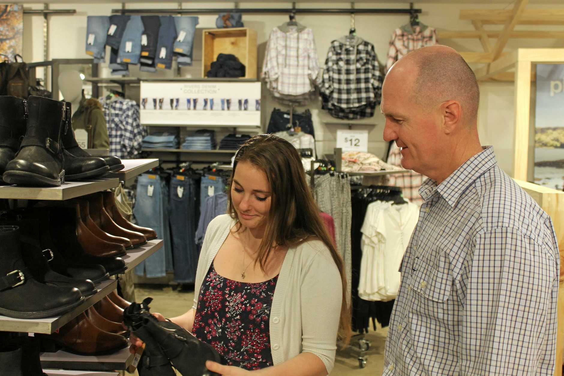 Rivers manager Katie Herd checks out merchandise at the new store with regional manager Paul Mollard.