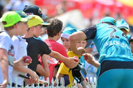 FANS: Kids fock to secure Heat player Jack Wildermuth's signature at Buderim.