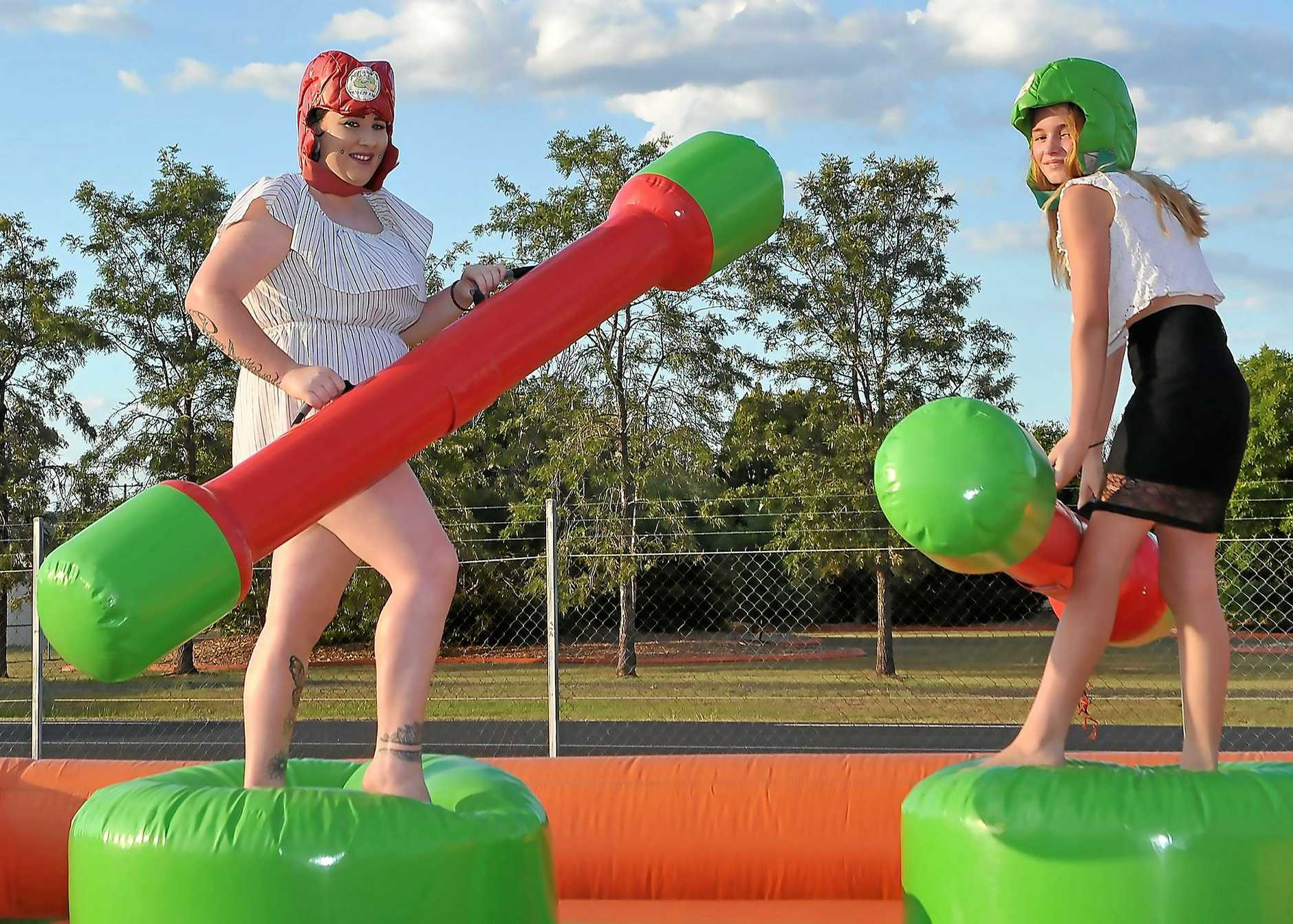 'Gladiator warriors' Kelly Gunther and Hayley Wilkinson get ready to battle at the mardi gras.