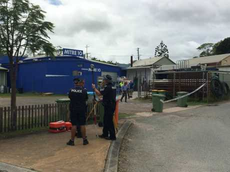Police investigate an incident at a Cooroy business in which a police officer was hit by a getaway car.