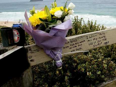 Friends left tributes to Mr Walsh at Budgewoi Beach, a popular spot for setting off fireworks.