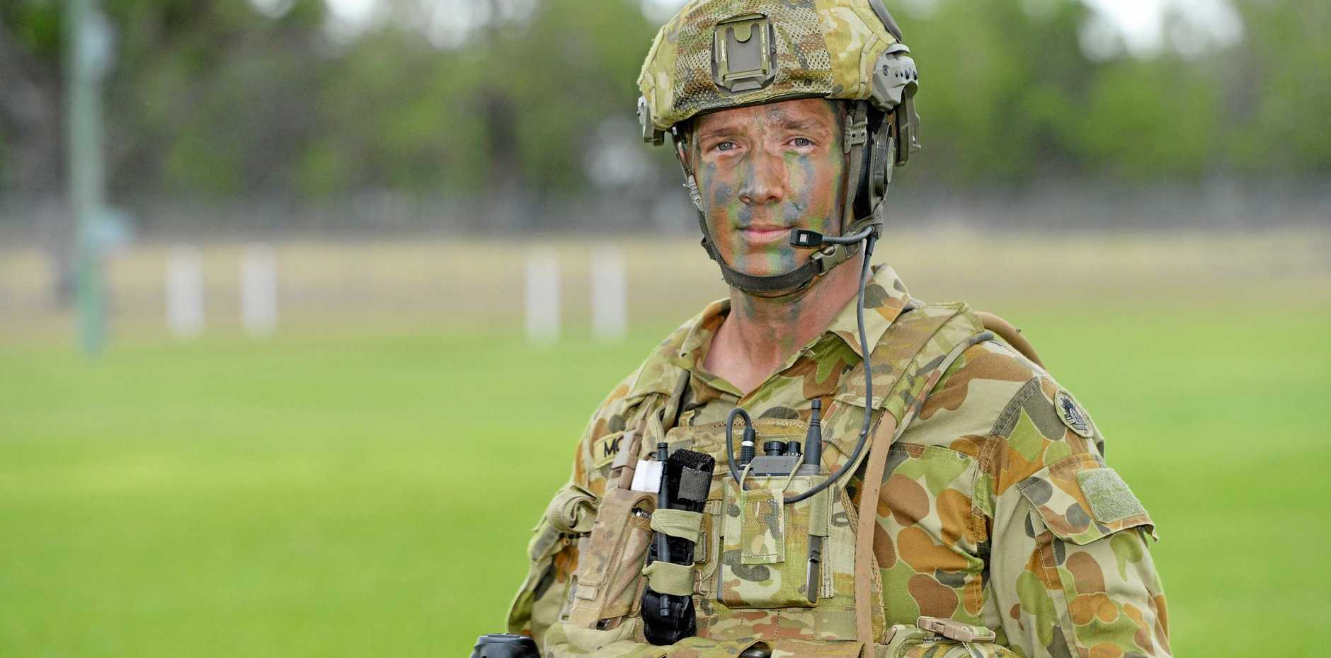 BIG ADVENTURE: Cpl Aaron McCosker from 31/42 RQR about to lead a building clearing exercise at the Western Street Barracks. He joined the Army Reserves at 19 before transfering to the regular army and serving in Afghanistan. Now he's studying to be a paramedic.