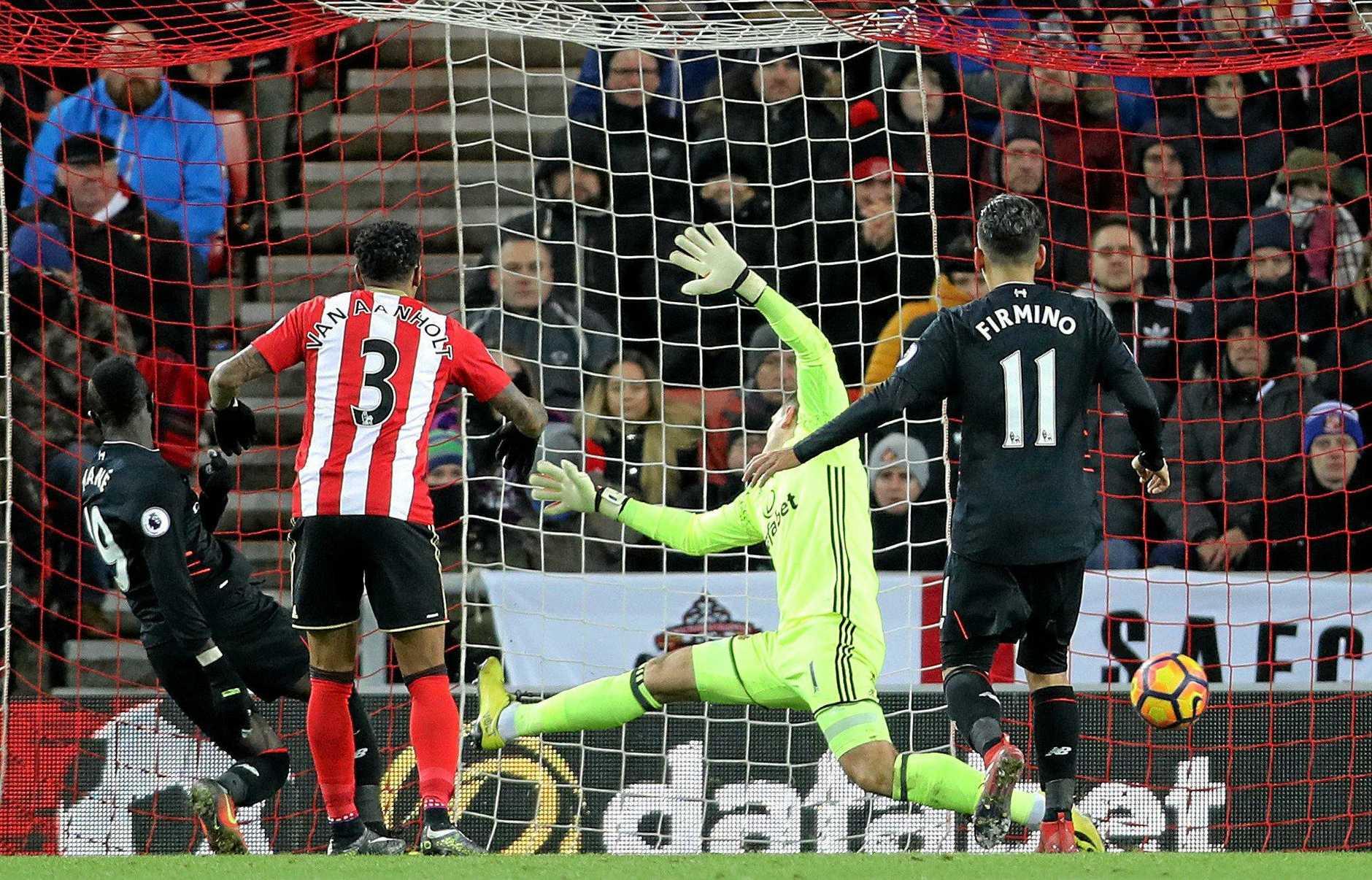 Liverpool's Sadio Mane (left) scores his side's second goal against Sunderland.