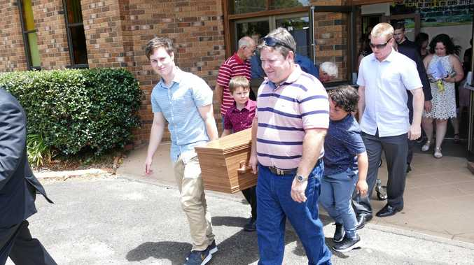 GONE NOT FORGOTTEN: Frank Inmon's sons, Nick, Brad and Brett and grandsons are the pallbearers for his coffin at the Grafton Salvation Army Hall on Tuesday.