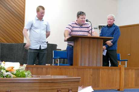 Frank Inmon's middle son, Nick, gives the eulogy at his funeral in the Salvation Army Hall, Grafton on Tuesday. Brothers Brad, left, and Brett joined him on stage.