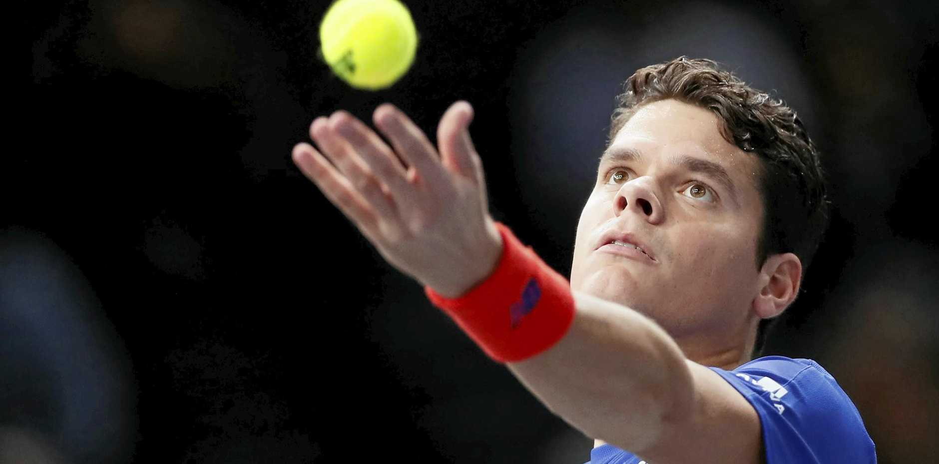 Milos Raonic of Canada winds up to serve.