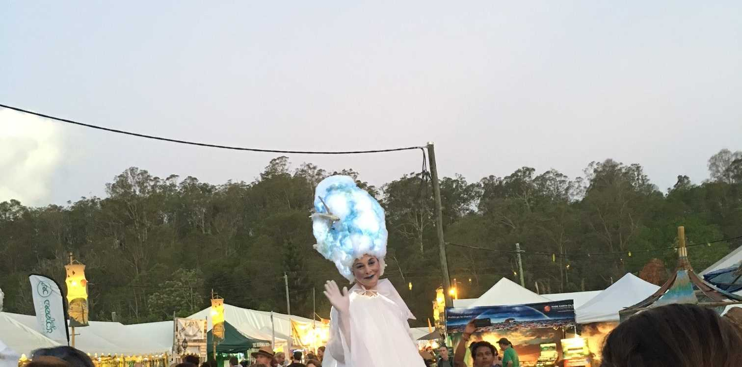 FESTIVAL AT IT'S BEST: The Woodford Angel walks amongst the crowds.