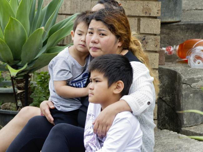 Relatives of Henry Tran, 2, at his Fairfield home where he was found in a pond.