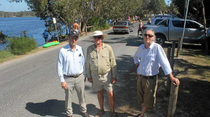 MIRACLE NEEDED: At Lake Ainsworth, Lennox Head, are (from left) Les Hynes, Stop the Lake Road Closure committee spokesperson Pip Carter and John Green.